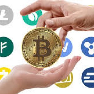 A hand placing a bitcoin into someone else's hand with images of other cryptocurrency logos in the background