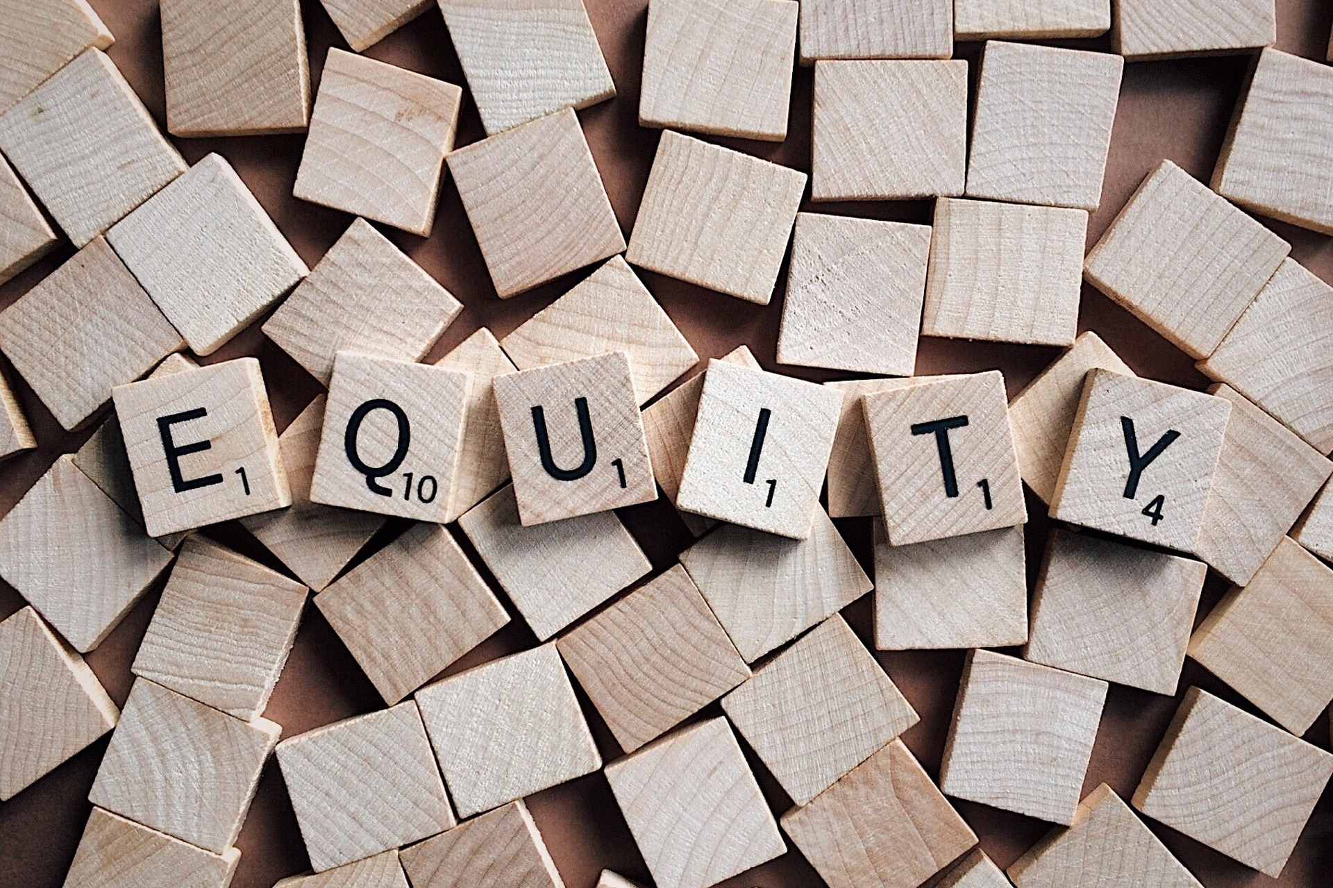 "The word ""equity"" spelled out in scrabble letters"