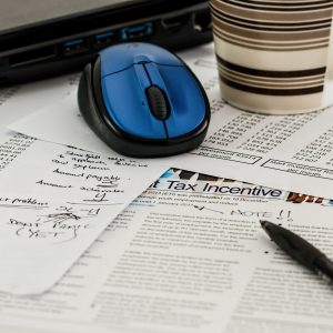 Tax forms, a mouse, and a pen