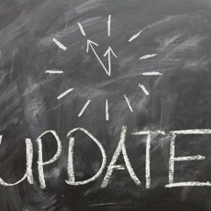 """A chalkboard with """"update"""" written on it"""